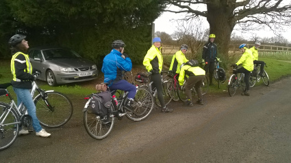 Graham pumping his tyre up while the group watch on